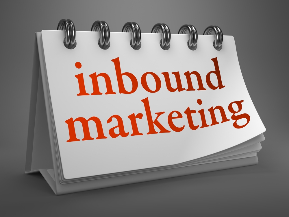 Inbound Marketing - Red Words on White Desktop Calendar Isolated on Gray Background.